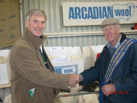 Peter congratulating Les on his win in the ewe weaner competition