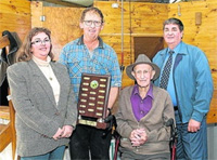 Angela and Gary Lock, Linda-Vista, Kongal receive the perpetual trophy for the winning two fleeces from Mundulla Hogget Competition founder Ed Champness, and Tony Biddle, representing sponsor Tatiara Insurance Agencies.